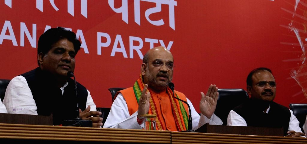 :New Delhi: BJP chief Amit Shah addresses a press conference regarding party's performance in the assembly elections in New Delhi on March 11, 2017. (Photo: IANS).