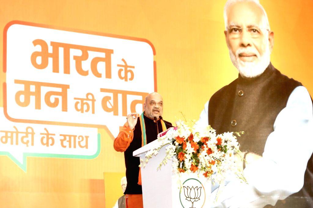 New Delhi: BJP chief Amit Shah addresses at the launch of 'Bharat ke mann ki baat, Modi ke saath' campaign in New Delhi, on Feb 3, 2019. (Photo: IANS) - Amit Shah