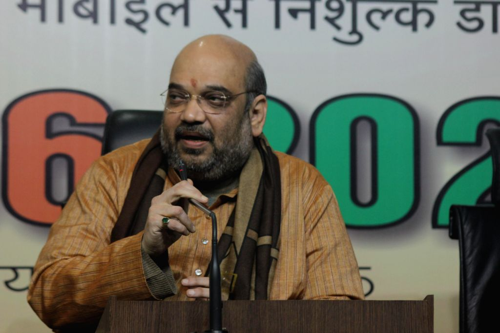 BJP Chief Amit Shah addresses during a programme organised at BJP office on `International Day for Persons with Disabilities` in New Delhi on Dec 3, 2014. - Amit Shah