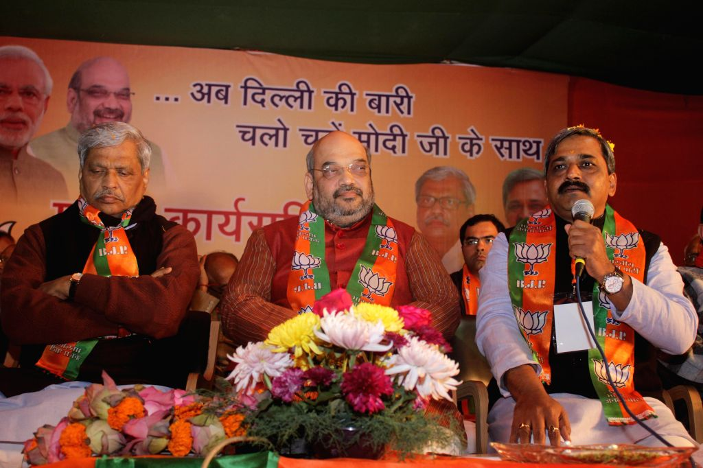 BJP chief Amit Shah and Delhi BJP chief Satish Upadhyay during a party programme in New Delhi, on Dec 30, 2014. - Satish Upadhyay