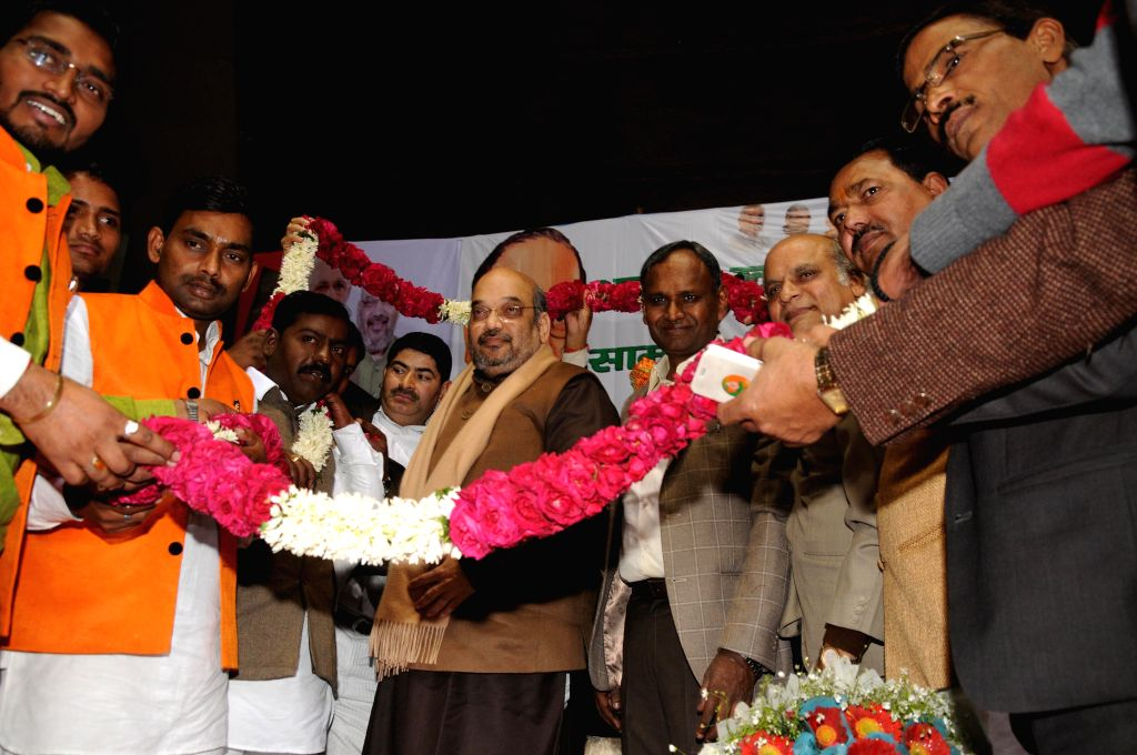 BJP  chief Amit Shah and party leader Udit Raj during a Dalit Sammelan at Talkatora Stadium in New Delhi, on Jan 16, 2015.