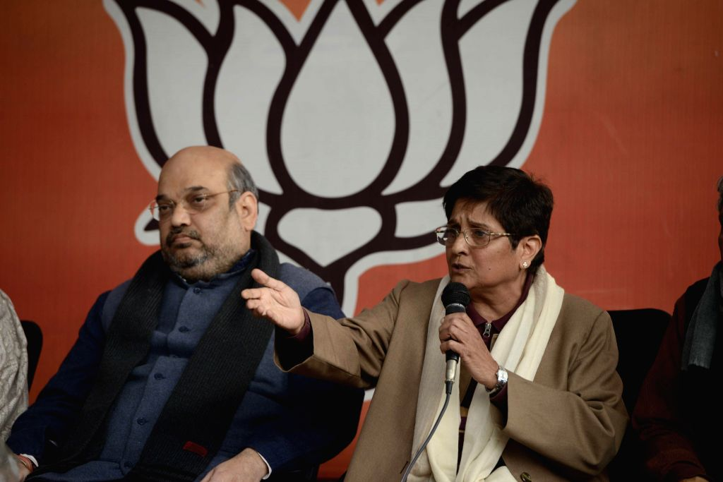 BJP chief Amit Shah and social activist Kiran Bedi during a programme organised to welcome Bedi in BJP on Jan 15, 2015. - Amit Shah