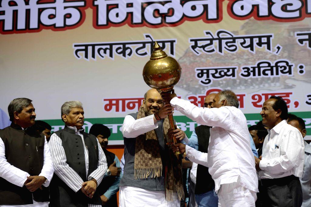 BJP chief Amit Shah being felicitated at the Valmiki Milan Utsav in New Delhi on Dec 1, 2014.