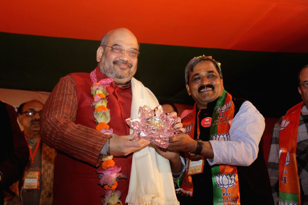 BJP chief Amit Shah being greeted by Delhi BJP chief Satish Upadhyay during a party programme in New Delhi, on Dec 30, 2014. - Satish Upadhyay