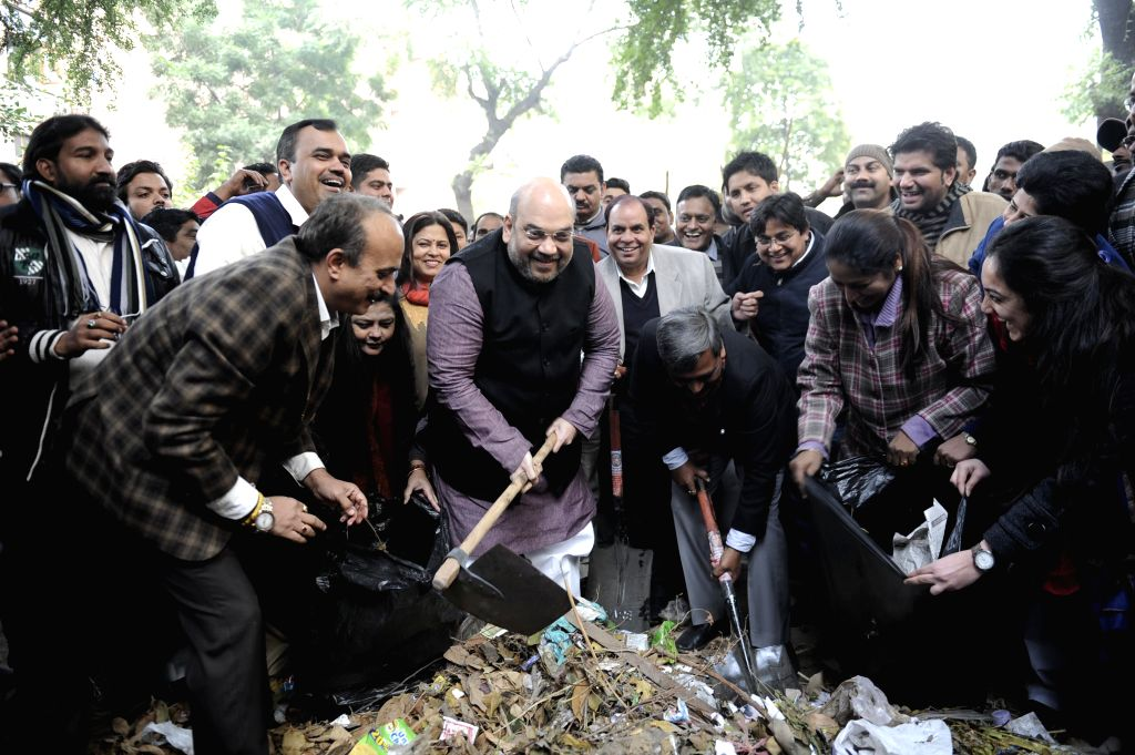BJP chief Amit Shah participates in Clean India Campaign at Gol Market in New Delhi, on Dec 25, 2014.