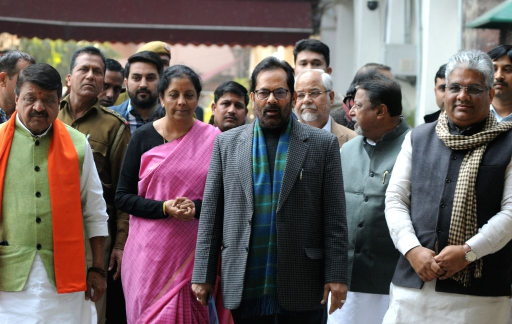 New Delhi: BJP delegation led by party leaders Kailash Vijayvargiya, Nirmala Sitharaman, Mukhtar Abbas Naqwi, Mukul Roy and Bhupender Yadav arrive after meeting the Chief Election Commissioner in New Delhi, on Feb 4, 2019. (Photo: IANS) - Mukul Roy and Bhupender Yadav