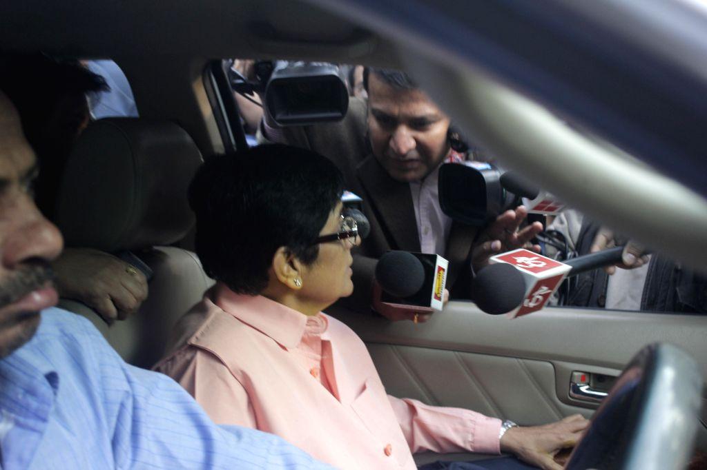 BJP leader Kiran Bedi arrives at a polling station in New Delhi on Feb. 7, 2015.