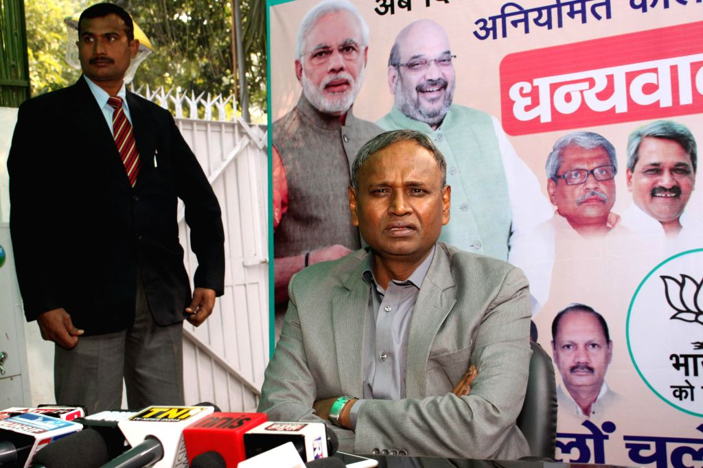 BJP leader Udit Raj addresses a press conference at his residence in New Delhi on Jan 15, 2015.