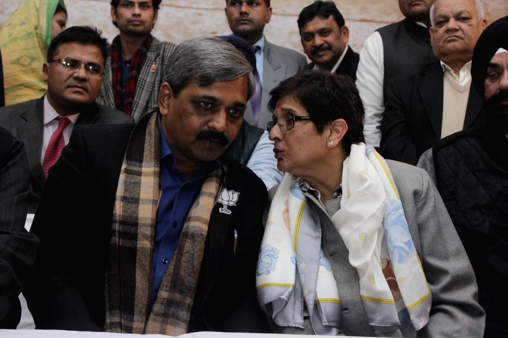 BJP leaders Kiran Bedi, Prabhat Jha,  state BJP president Satish Satish Upadhyay and others during a press conference at party office in New Delhi on Jan. 29, 2015. - Satish Satish Upadhyay