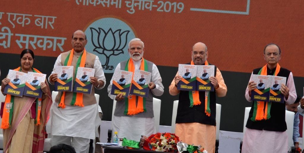 New Delhi: BJP leaders - Prime Minister Narendra Modi, party chief Amit Shah and Union Ministers Sushma Swaraj, Rajanth Singh and Arun Jaitley release the party' election manifesto for the 2019 Lok Sabha polls, in New Delhi on April 8, 2019. (Photo:  - Narendra Modi, Sushma Swaraj, Rajanth Singh, Arun Jaitley and Amit Shah