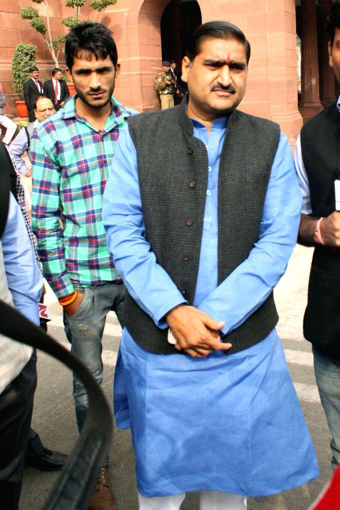 BJP MP from Aligarh Satish Goutam at the Parliament premises in New Delhi, on Nov 28, 2014.