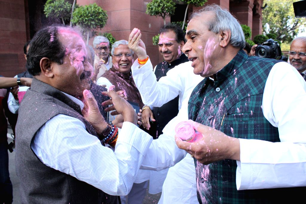 BJP MP Jagdambika Pal and other parliamentarians celebrate Holi at the Parliament in New Delhi, on March 4, 2015.