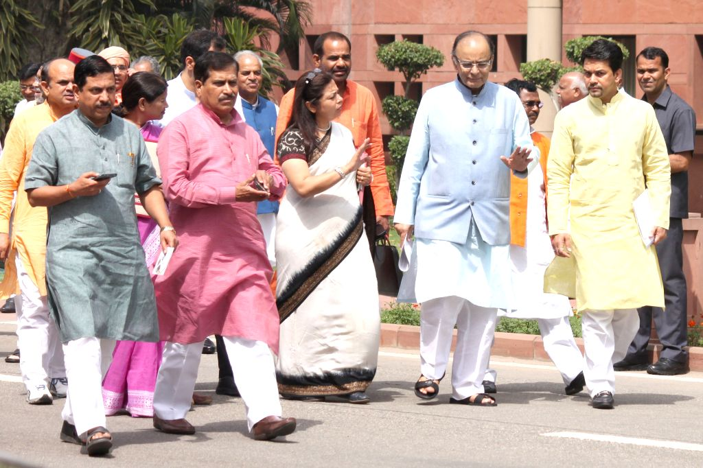 BJP MPs Meenakshi Lekhi, Anurag Thakur and others with Union Minister for Finance, Corporate Affairs, and Information and Broadcasting Arun Jaitley at the Parliament in New Delhi, on April ... - Arun Jaitley