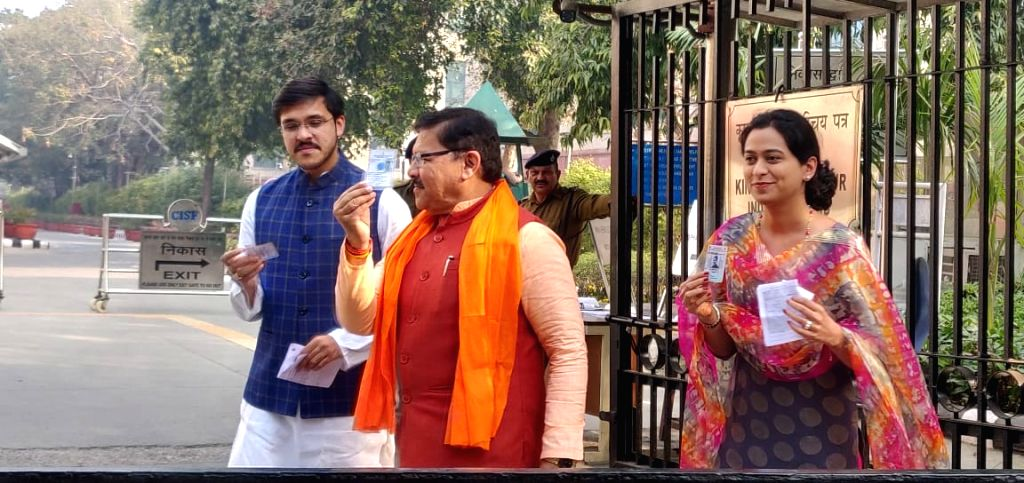 New Delhi: BJP National Vice President Shyam Jaju shows his Voter ID as he arrives to cast his vote for the Delhi Assembly elections 2020, at a polling booth in New Delhi on Feb 8, 2020. (Photo: IANS) - Shyam Jaju