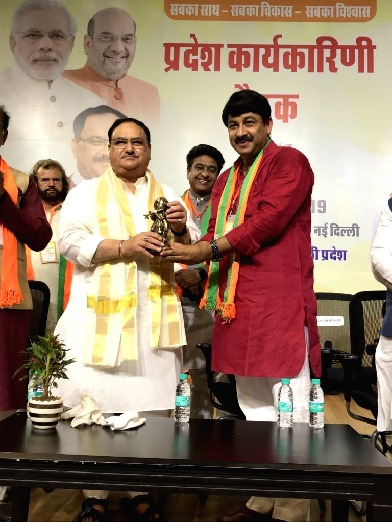New Delhi: BJP National Working President J.P. Nadda being welcomed by the party's Delhi President Manoj Tiwari at the inaugural session of the Delhi BJP Working Committee meeting, in New Delhi on June 29, 2019. (Photo: IANS/BJP)