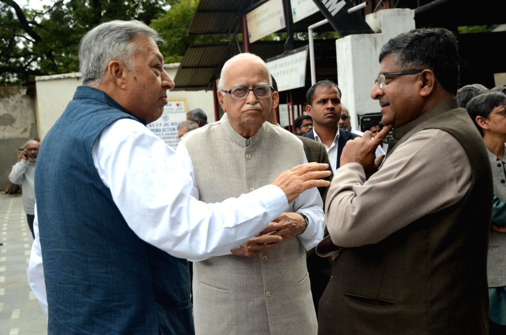 BJP veteran and MP from Gandhinagar L K Advani with the Union Minister for Communications & Information Technology Ravi Shankar Prasad at the funeral of prominent journalist and writer ...