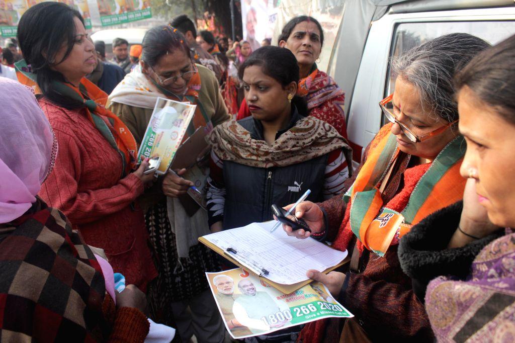 BJP workers enroll new members during a membership drive at Jhanda Wala in New Delhi, on Dec 30, 2014.
