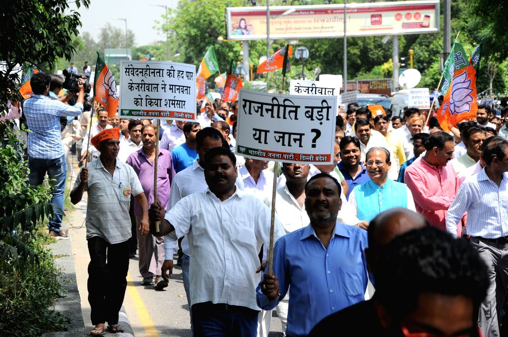 BJP workers participate in a demonstration organised to protest against a farmer's suicide at the venue of Aam Aadmi Party (AAP) rally in New Delhi on April 23, 2015.