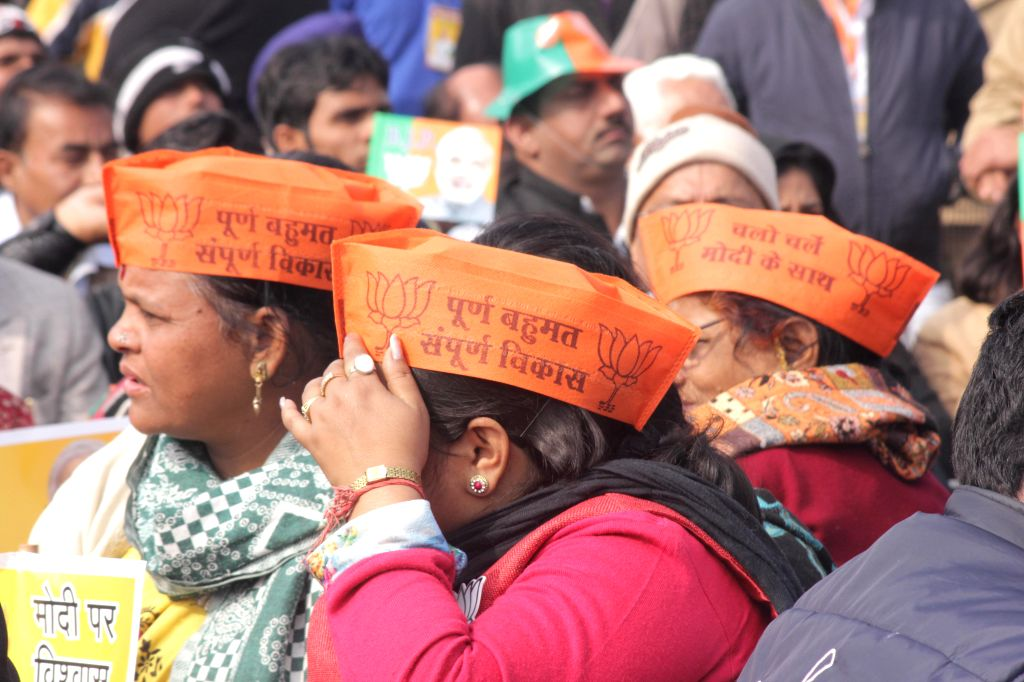 BJP workers participate in a rally organised to celebrate party's success in the recently concluded assembly polls in Jharkhand and Jammu and Kashmir at Ramlila Maidan in New Delhi on Jan .