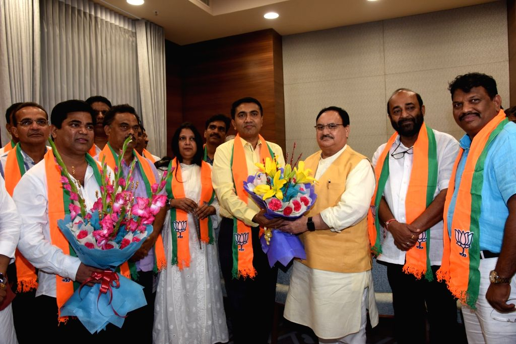 New Delhi: BJP Working President J.P. Nadda welcomes 10 Congress MLAs from Goa into the party at the BJP headquarters, in New Delhi on July 11, 2019. Also seen Goa Chief Minister Pramod Sawant. (Photo: IANS) - Pramod Sawant