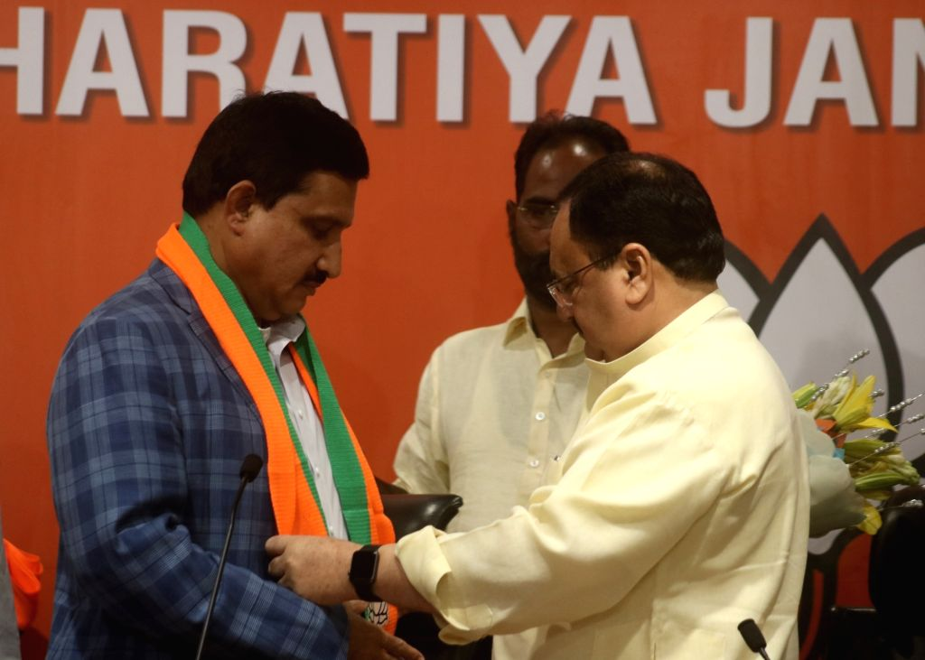New Delhi: BJP Working President J.P. Nadda welcomes TDP MP Y. S. Chowdary into the party at the party's headquarters in New Delhi on June 20, 2019. (Photo: IANS)
