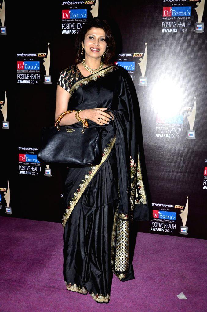 Bollywood actor Varsha Usgaonkar during the Dr Batra's 9th Positive Health awards 2014, Mumbai on Nov 13, 2014. - Varsha Usgaonkar