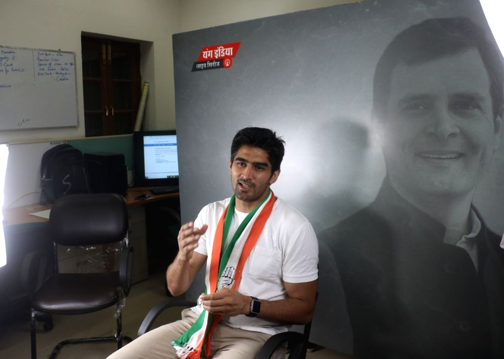 New Delhi: Boxer and Congress' Lok Sabha candidate from South Delhi, Vijender Singh visits the headquarters of the party's youth wing - Indian Youth Congress (IYC) during an election campaign for the forthcoming Lok Sabha elections, in New Delhi on A - Vijender Singh