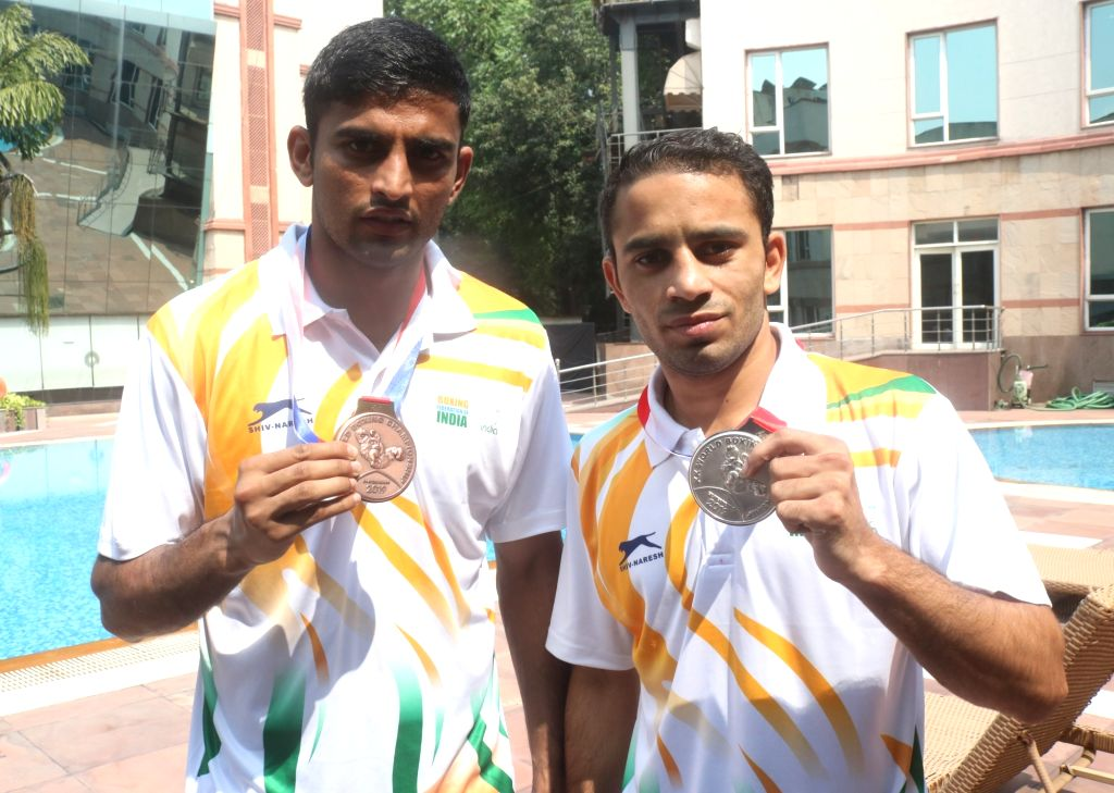 New Delhi: Boxers Manish Kaushik and Amit Panghal, who clinched a Bronze and a Silver each at the Men's World Boxing Championships, during an interactive session, in New Delhi on Sep 23, 2019. (Photo: IANS)