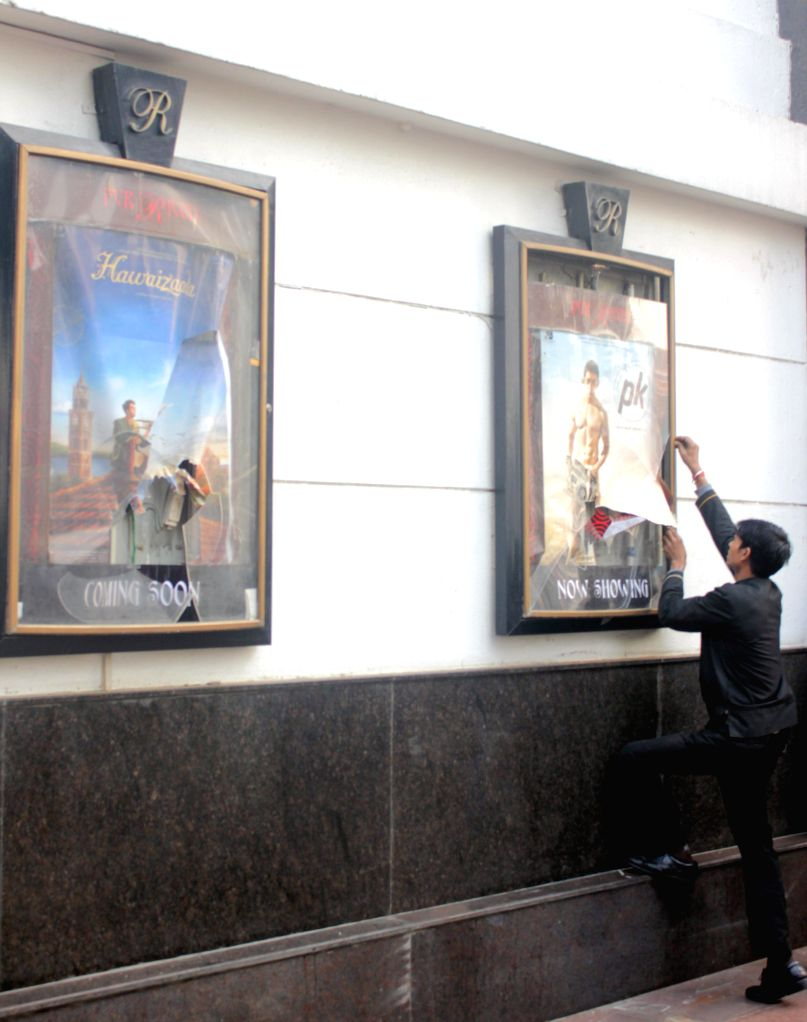 Broken posters frame  at a Delhi theatre screening Amir Khan starrer `PK`  in New Delhi, on Dec 28, 2014. Some people staged a protest against the film at the theatre. - Khan