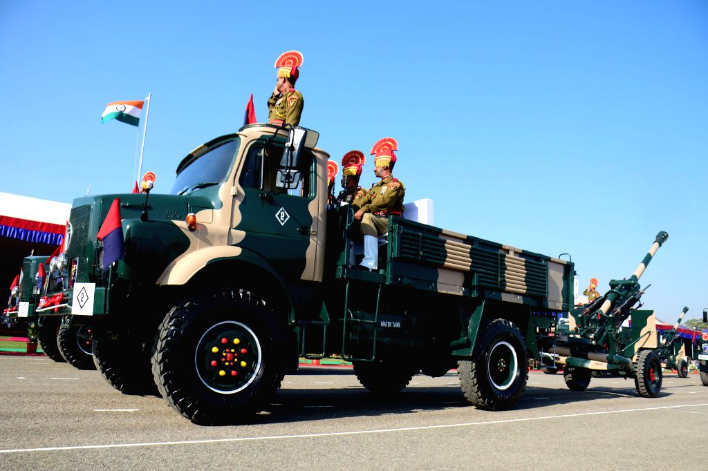 BSF personnel participate in BSF Raising Day parade held in New Delhi on Dec 1, 2014.