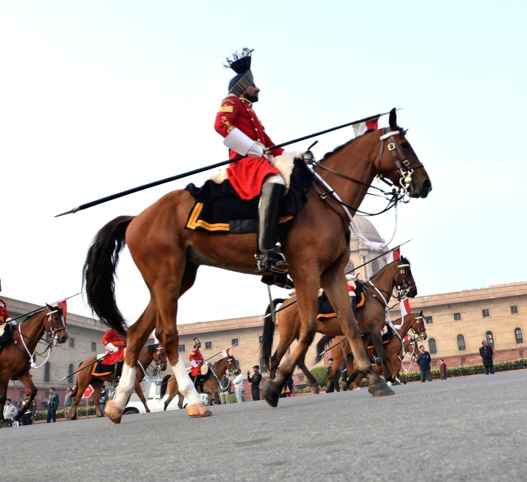 BSF soldiers atop camels participating at the full-dress rehearsal of Beating the Retreat ceremony at Raisina Hill in New Delhi on Jan. 27, 2015.