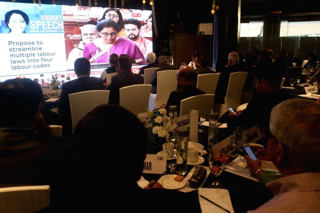 New Delhi: Business leaders watch the telecast of the presentation of Union Budget 2019 by Union Finance Minister Nirmala Sitharaman in the Lok Sabha; at CII in New Delhi on July 5, 2019. (Photo: IANS) - Nirmala Sitharaman