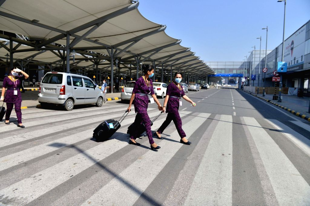 New Delhi: Cabin crew of Vistara Airlines arrive at the Indira Gandhi International Airport after India resumed civil passenger flight services on Monday, exactly two-months after it had suspended these operations due to the outbreak of Covid-19, in