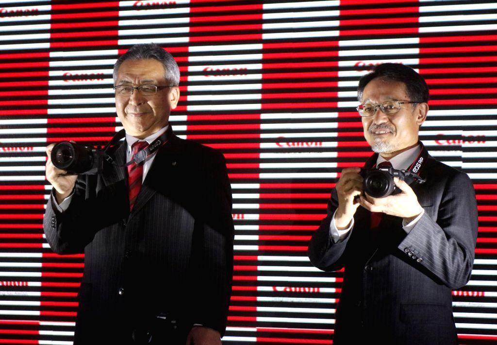 New Delhi: Canon India, President and CEO Kazutada Kobayashi launches Canon EOS RP camera in New Delhi, on Feb 27, 2019. (Photo: IANS)
