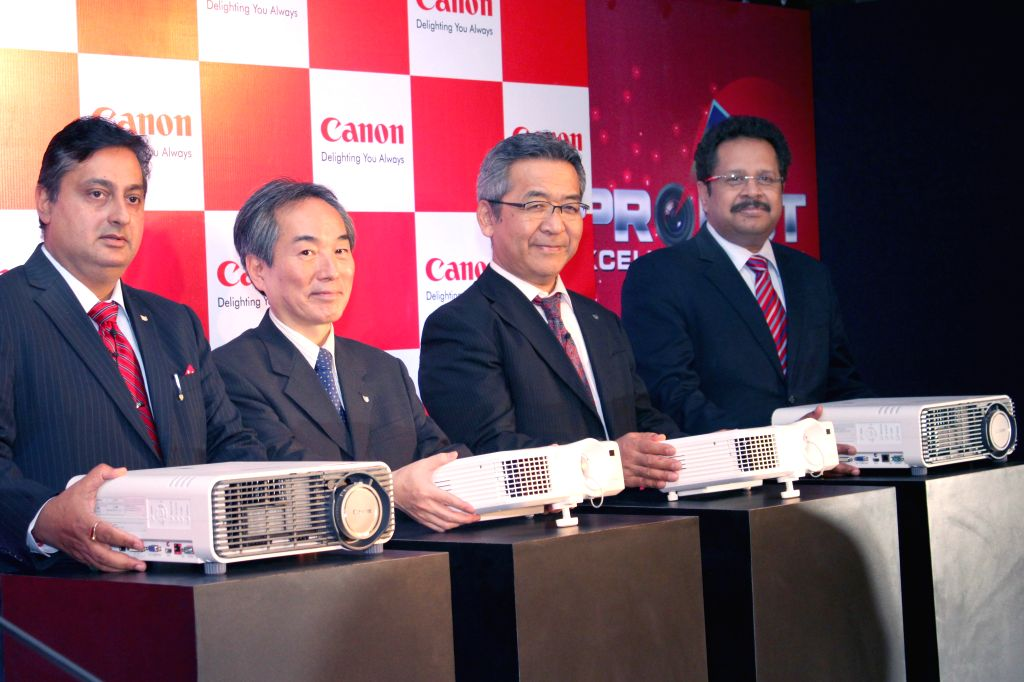 Canon Senior General Manager Yasuhiko Hoshino, CEO Kazutada Kobayashi and others at the launch of new range of Canon projectors in New Delhi, on April 14, 2015.