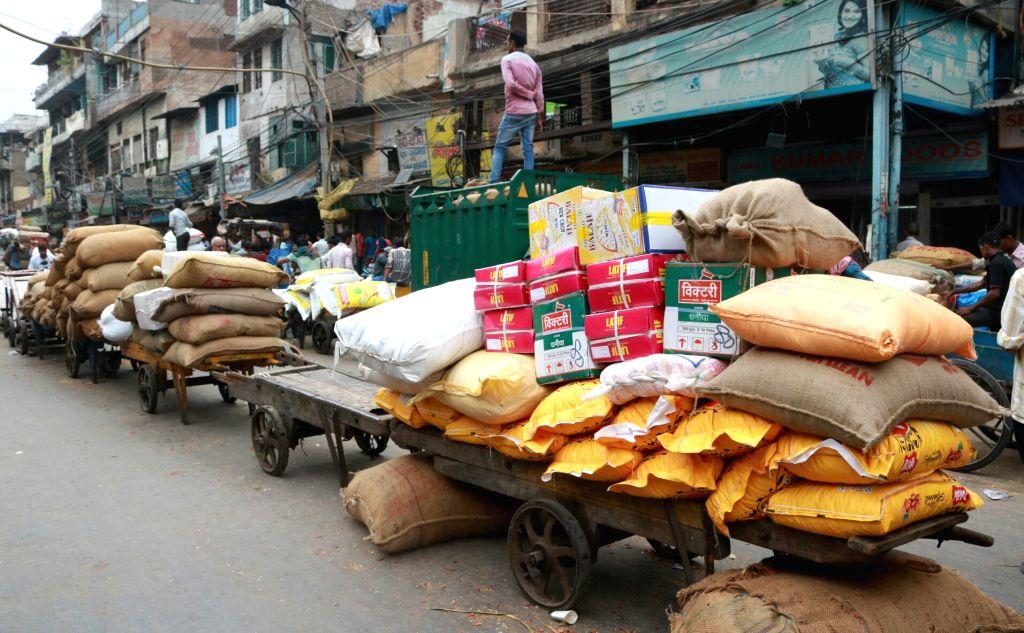 New Delhi: Carts parked outside the shops in Khari Baoli whole sale market near Chandni Chowk, in New Delhi. (File Photo: IANS)