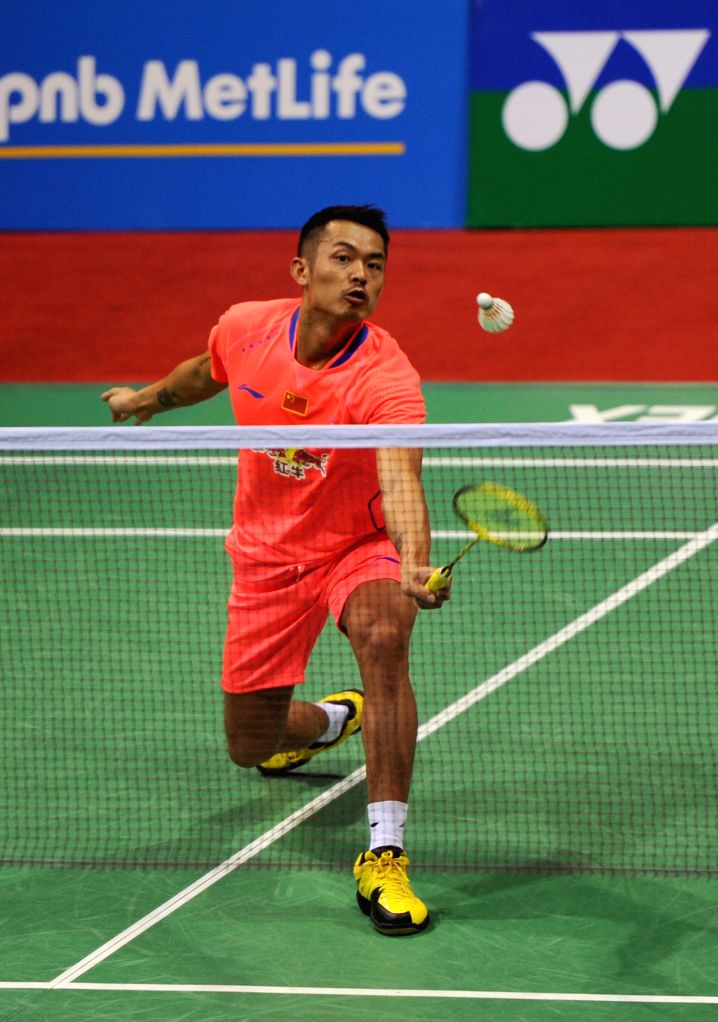 Chinese badminton player Lin Dan returns a shot to Wang Wei Tzu of Chinese Taipei during the first round of the men's singles match of Yonex Sunrise Indian Open Badminton Championship in ...