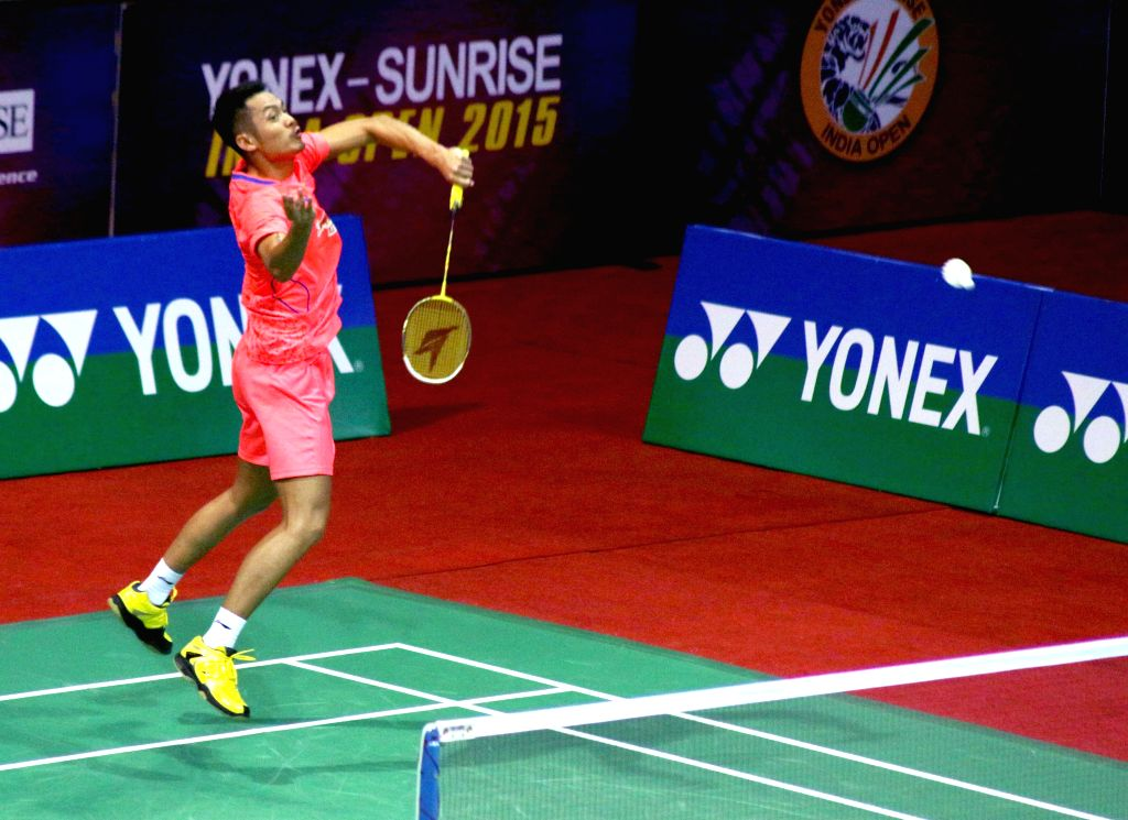 Chinese badminton player Lin Dan returns a shot to Tommy Sugiarto of Indonesia during the men`s singles match of Yonex Sunrise Indian Open Badminton Championship in New Delhi on March 27, ...