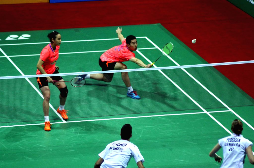 Chinese badminton players Chai Biao and Hong Wei in action against their Danish counterparts Mads Pieler Kolding and Mads Conrad-Petersen during a match of Yonex Sunrise Indian Open ...