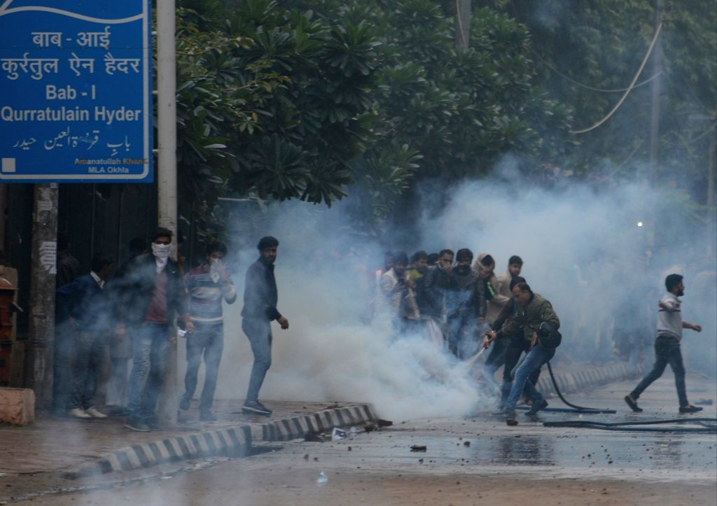 New Delhi: Clashes break out in New Delhi as Jamia Millia Islamia students pelted stones on security forces outside Jamia Millia Islamia after they take out a protest march to Parliament to oppose the Citizenship Amendment Bill 2019 which has now bec