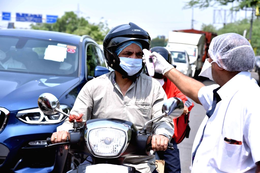 New Delhi: Commuters at the Delhi-Noida Border being thermal screened for COVID-19 during the extended nationwide lockdown imposed to mitigate the spread of coronavirus; on Apr 22, 2020. (Photo: IANS)