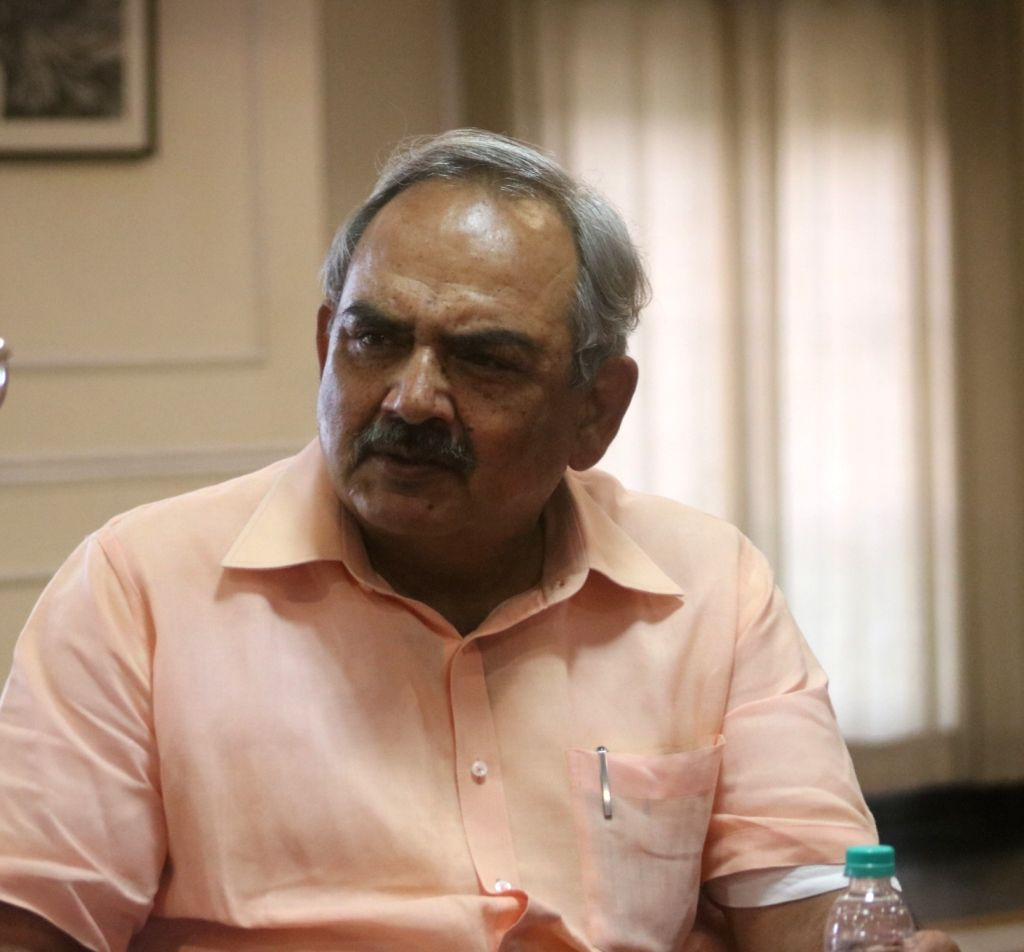 """:New Delhi: Comptroller and Auditor General of India Rajiv Mehrishi at """"Third Eye - II"""" an exhibition of photographs by Ashwini Attri in New Delhi on Oct 5, 2018. (Photo: IANS)."""