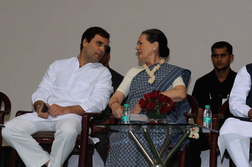 Congress chief Sonia Gandhi and party vice-president Rahul Gandhi during a programme organised on the eve of 125th birth anniversary of Jawaharlal Nehru at Talkatora stadium in New Delhi, . - Sonia Gandhi and Rahul Gandhi