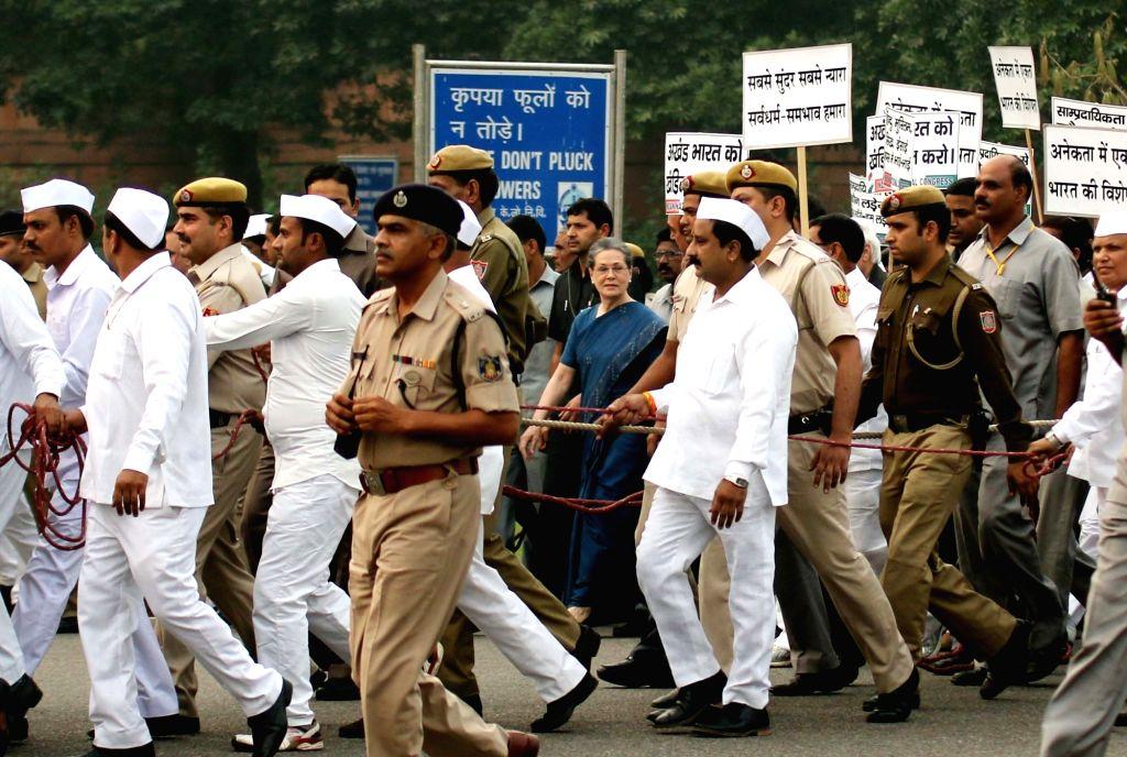 :New Delhi: Congress chief Sonia Gandhi  during a protest march against intolerance  in New Delhi, on Nov 3, 2015. (Photo: IANS).