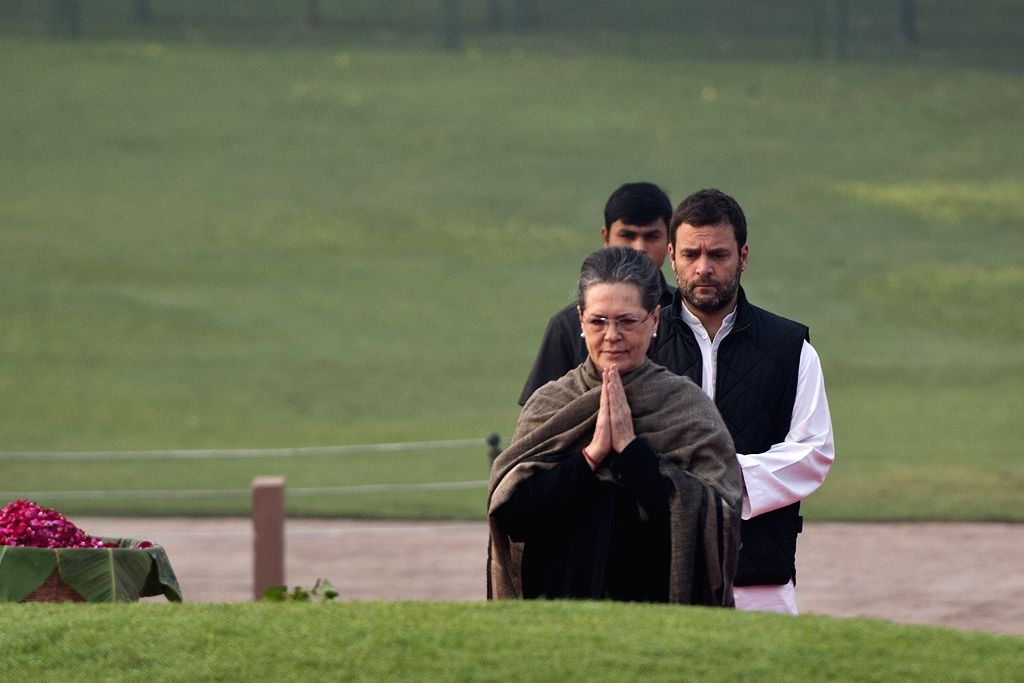 : New Delhi: Congress chief Sonia Gandhi pays floral tribute at the Samadhi of the former Prime Minister Pandit Jawaharlal Nehru on his 126th birth anniversary, at Shantivan, in New Delhi on Nov 14, ...