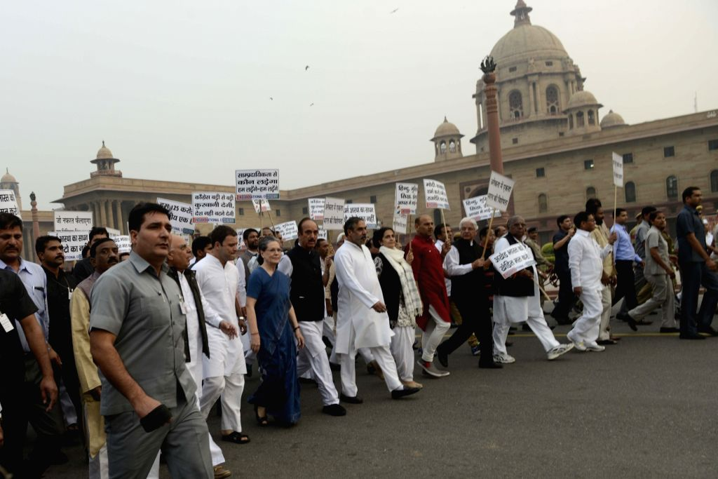 :New Delhi: Congress chief Sonia Gandhi, vie president Rahul Gandhi, party leaders Anand Sharma, Ghulam Nabi Azad and others during a protest march against intolerance  in New Delhi, on Nov 3, ... - Narendra Modi, Sonia Gandhi and Pranab Mukherjee