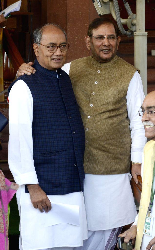 Congress General Secretary Digvijay Singh with JD (U) chief Sharad Yadav at the Parliament premises in New Delhi, on Nov 25, 2014. - Sharad Yadav