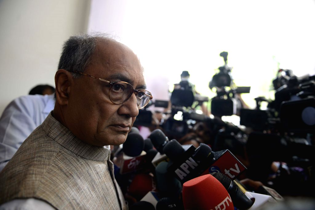 : New Delhi: Congress general secretary Digvijaya Singh addresses after the Congress Working Committee meeting in New Delhi, on April 17, 2015. (Photo: IANS). - Nitin Gadkari and Digvijaya Singh
