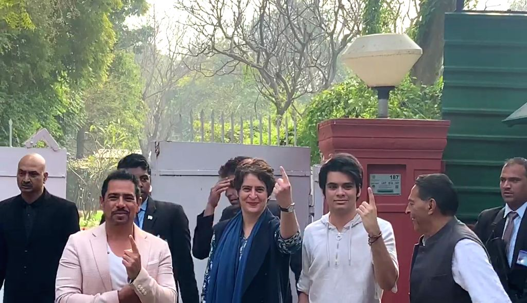 New Delhi: Congress General Secretary Priyanka Gandhi Vadra, her husband Robert Vadra and their son Raihan Vadra show their inked fingers after casting their votes for the Delhi Assembly elections 2020 at a polling booth in central Delhi's Nirman Bha
