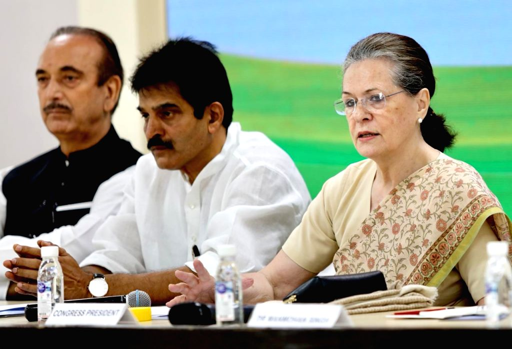 New Delhi: Congress interim President Sonia Gandhi with party leaders Ghulam Nabi Azad and K. C. Venugopal during a meeting of party general secretaries, state in-charges, state unit chiefs and others at party Headquarters in New Delhi on Sep 12, 201 - Sonia Gandhi